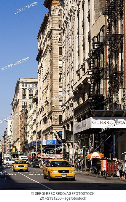 Broadway in Tribeca / Soho, Lower Manhattan, New York City. Broadway Street through the Soho and Tribeca. The neighborhood of TriBeCa is one of many that are...
