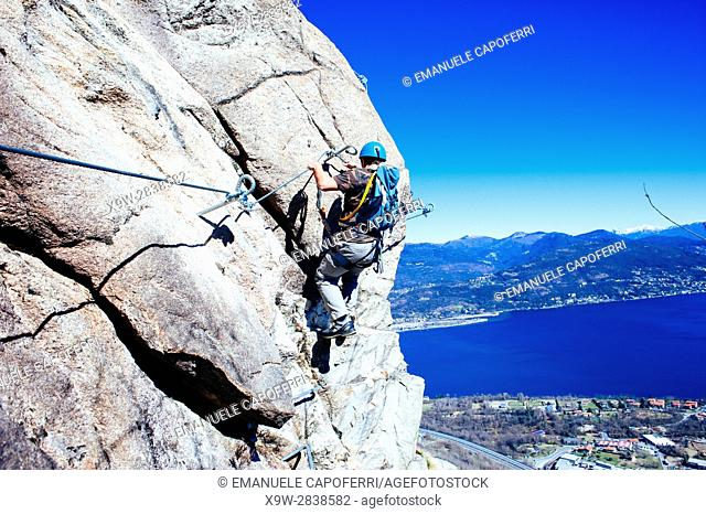 mountaineer along via ferrata, Baveno, Piedmont, Italy, Lake Maggiore