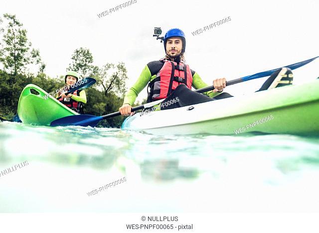 Germany, Bavaria, Allgaeu, couple kayaking on river Iller
