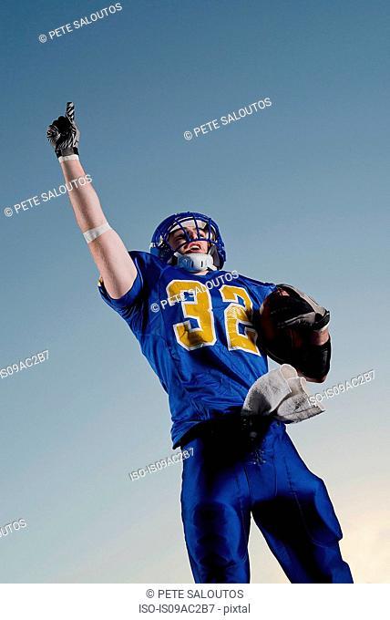 American footballer pointing towards sky