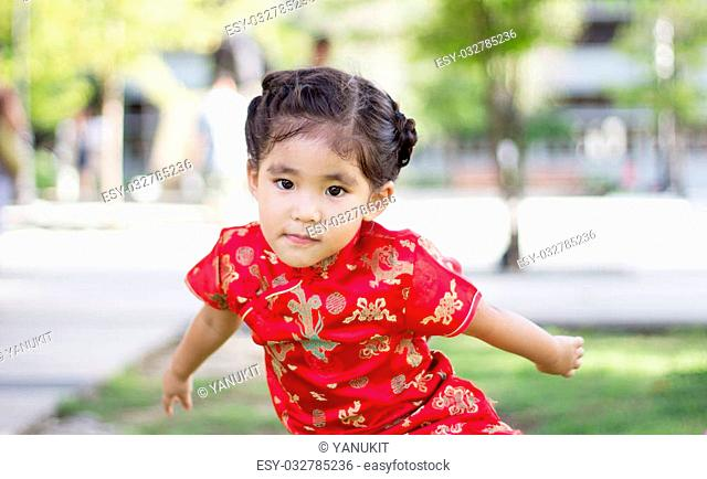 close up asian Chinese girl in red dress action funny