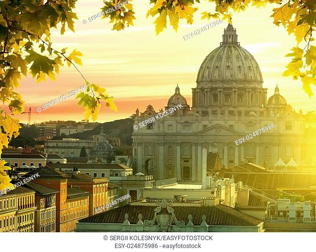 View on Vatican and roofs of houses at sunset in autumn, Rome, Italy