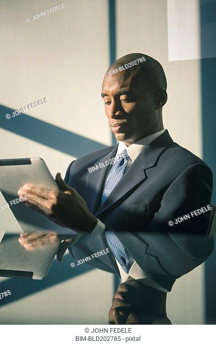 Black businessman using tablet computer
