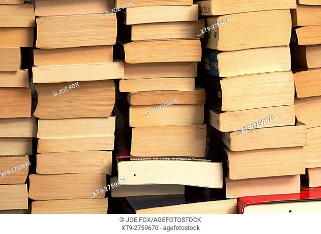 pile of stacks of used paperback books in the uk