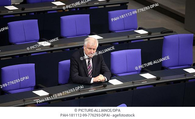 09 November 2018, Berlin: Horst Seehofer (CSU), Federal Minister of the Interior, sits on the government bench at the beginning of a commemoration ceremony in...