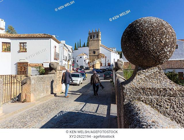 Ronda, Malaga Province, Andalusia, southern Spain. Crososing the Puente Viejo, or Old Bridge, towards the Iglesia de Nuestro Padre Jesus