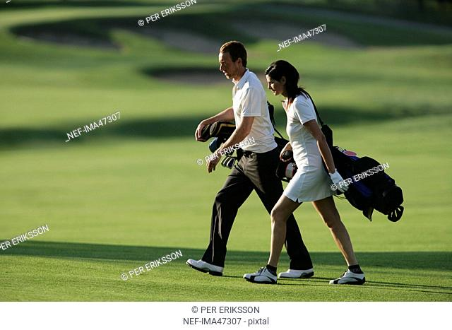 A Scandinavian man and woman playing golf, Italy