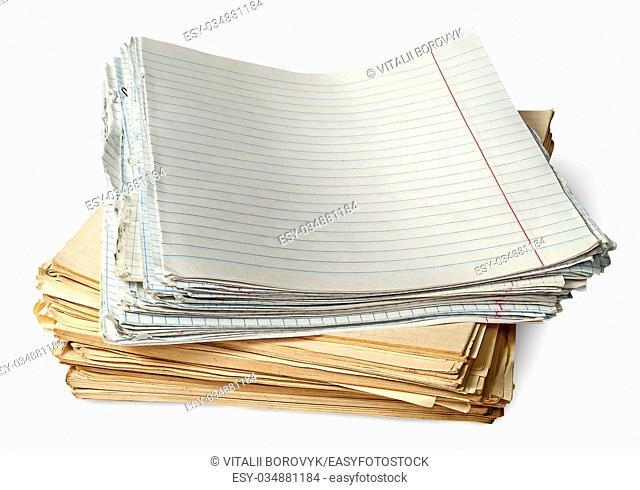 Stack of old yellowed sheets of school notebooks isolated on white background
