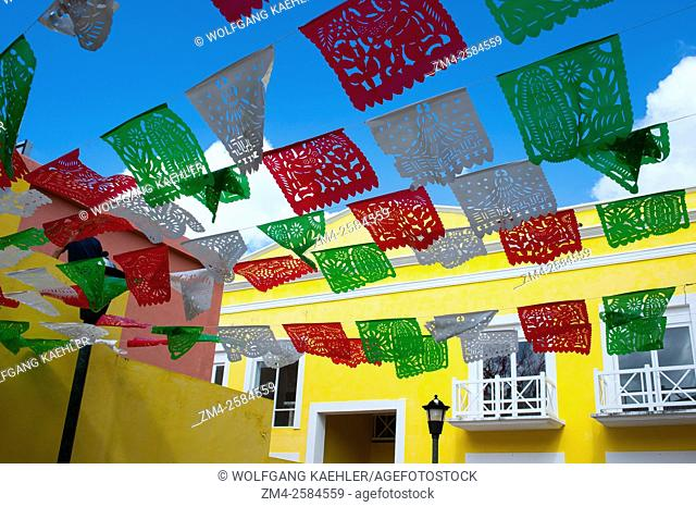 Mexican Papel Picado decorations over a street in San Miguel de Cozumel on Cozumel Island near Cancun in the state of Quintana Roo, Yucatan Peninsula, Mexico