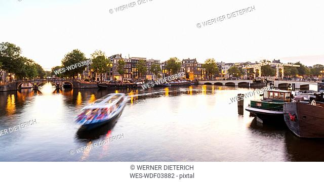 Netherlands, Amsterdam, view to the old town and Magere Brug with Amstel River in the foreground