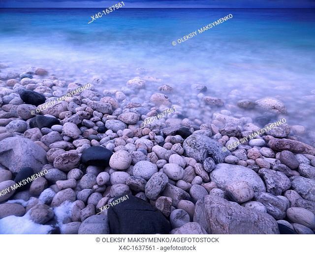Pebbles on a shore of Georgian Bay  Wintertime scenic landscape  Bruce Peninsula National Park, Ontario, Canada