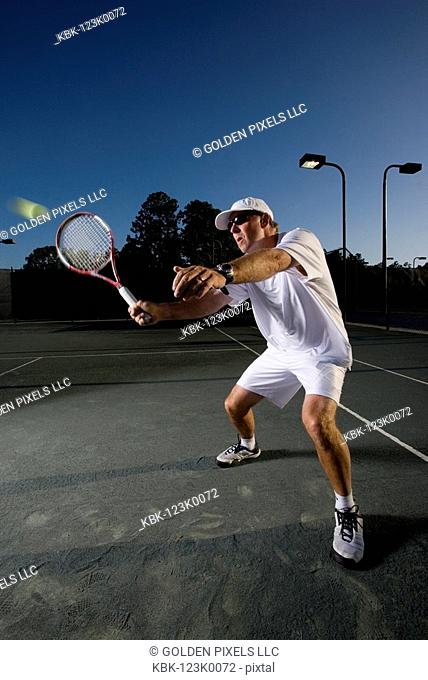 Tennis player hitting a volley
