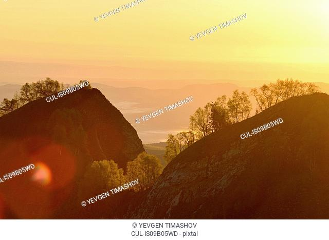 Silhouetted landscape at dusk, Bolshoy Thach (Big Thach) Nature Park, Caucasian Mountains, Republic of Adygea, Russia