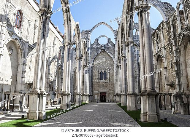 Ruins of the Convento do Carmo (Carmo Convent) damaged during the 1755 earthquake. Remnants of the church nave under a blue sky
