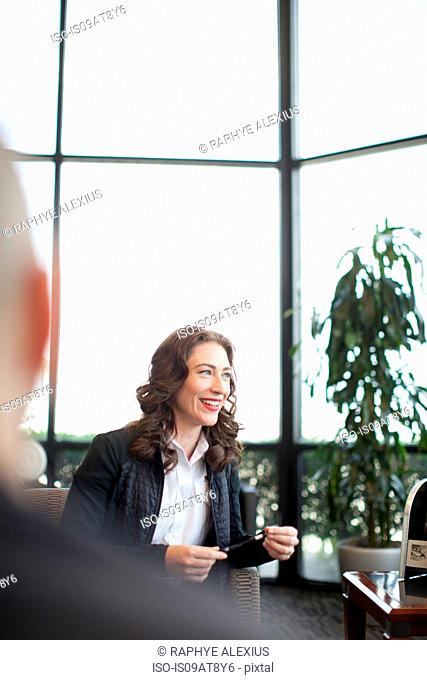 Business woman waiting in airport lounge