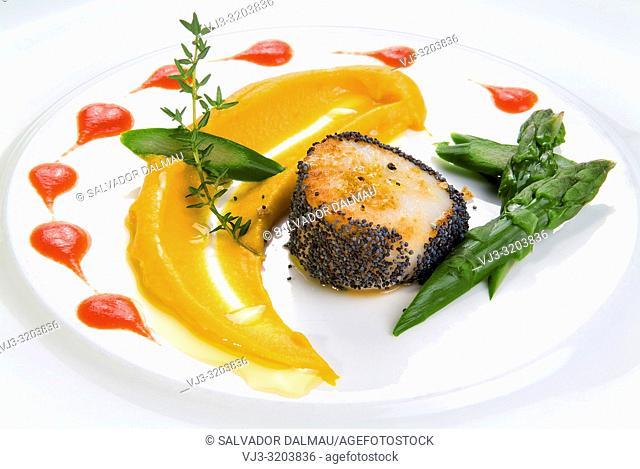 hake breaded with pumpkin sauce and asparagus,studio photography of girona,catalonia,spain,