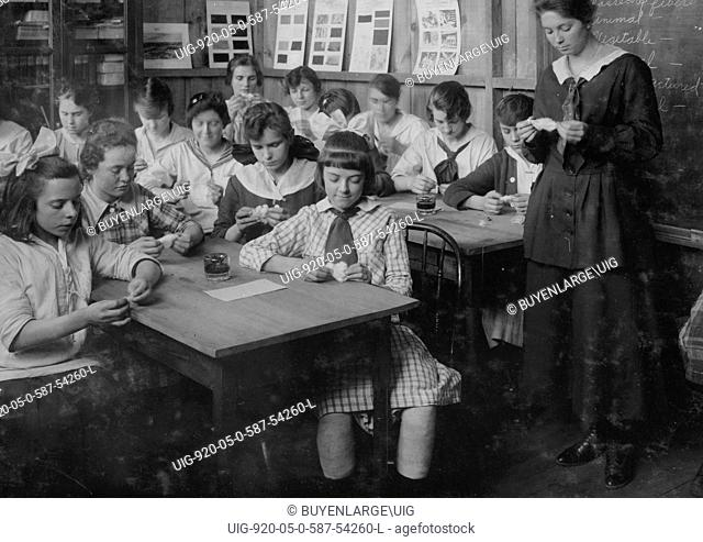 Continuation School group at Ipswich Mills, South Boston, studying textiles. 1917