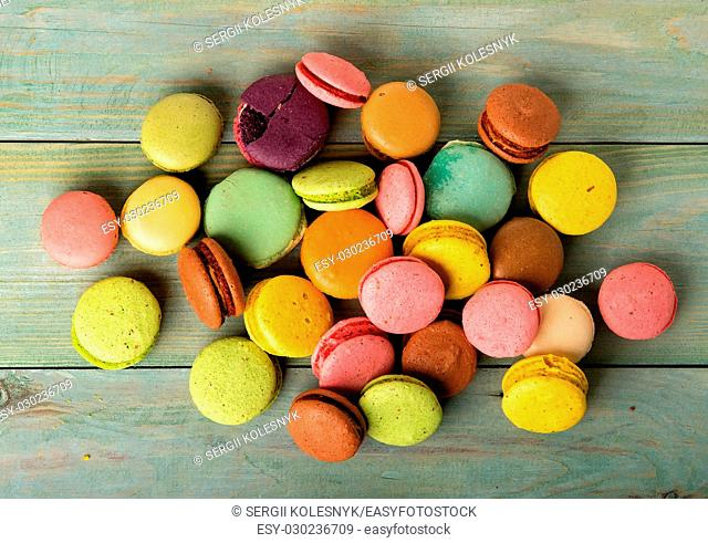 Assortment of sweet macarons on a wooden table