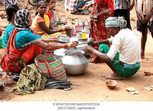 Women selling Madi (Liquor), Dhurwa Tribal Market, Pandripani Village, Chattisgadh, India