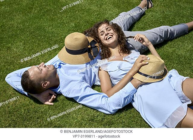 Couple lying on meadow