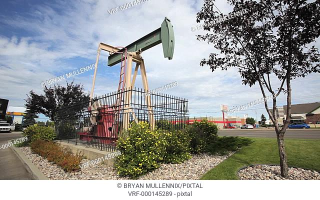Pumpjack pumping oil in downtown Edmonton, Alberta