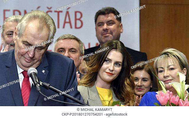 The pro-Russian Incumbent Milos Zeman with his wife Ivana, right, and daughter Katerina, center, claims victory in the Czech presidential election in Prague