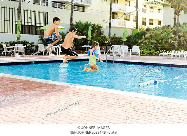 Children jumping into pool