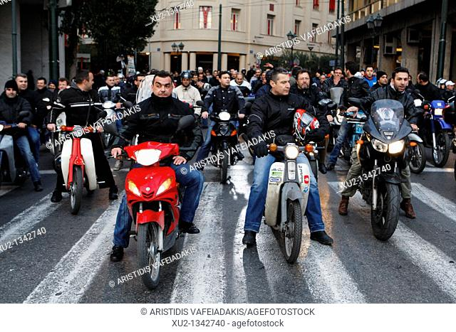 Transport workers protest on motorcycles against a public transport sector shakeup that is part of Greece's cost-cutting reforms to improve public finances