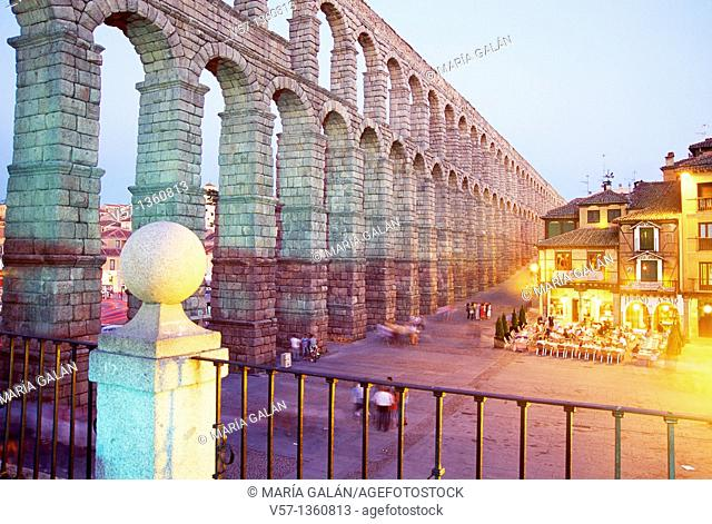 Roman Aqueduct and Azoguejo square from the viewpoint, night view. Segovia, Castilla León, Spain