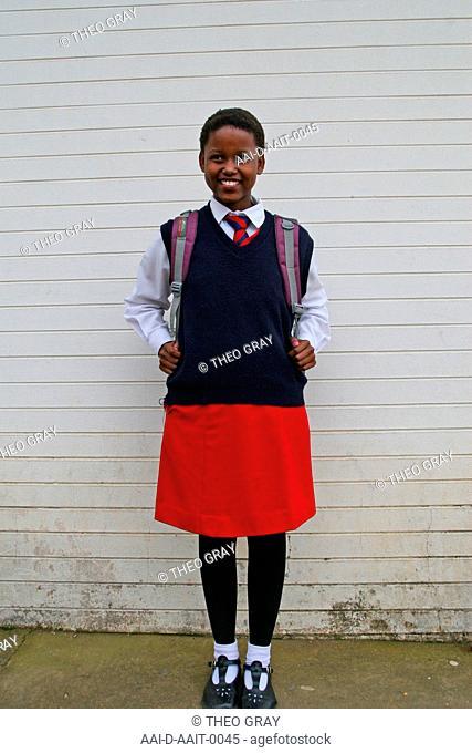 School girl outside classroom, St Mark's School, Mbabane, Hhohho, Kingdom of Swaziland
