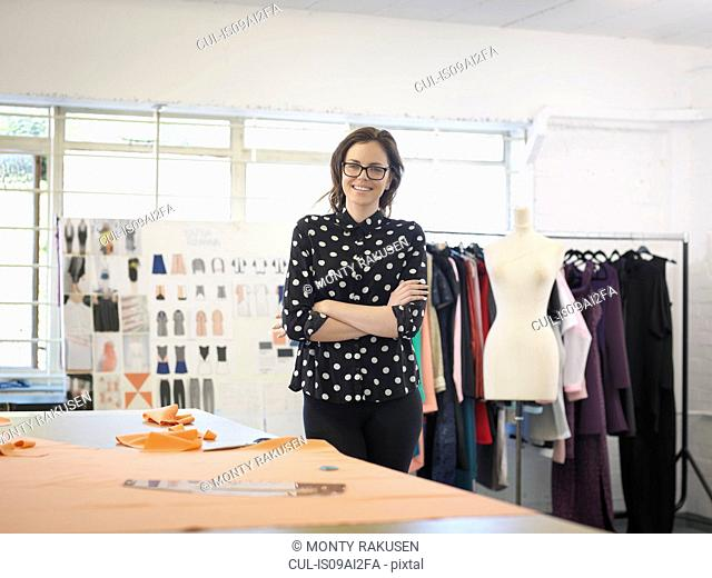 Fashion designer in fashion design studio, portrait