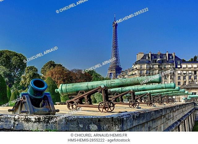 France, Paris, Hotel des Invalides, military museum, cannons and the Eiffel tower on the background