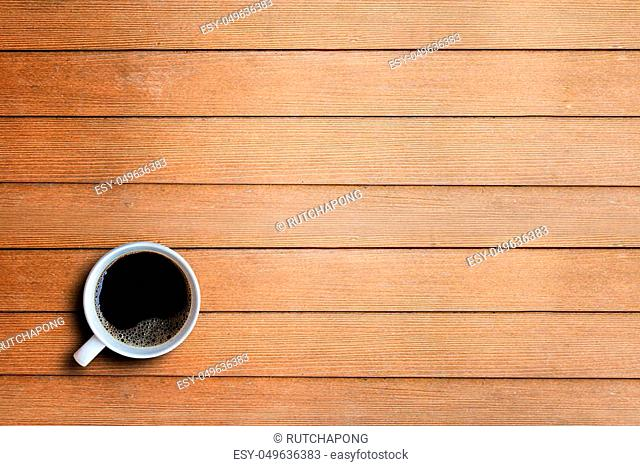 Coffee cup on wooden table background with copy space. top view