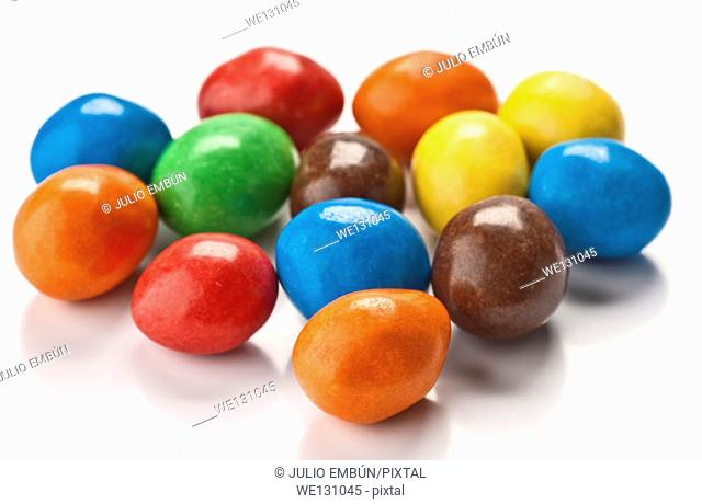 group of colored chocolate balls, on white base