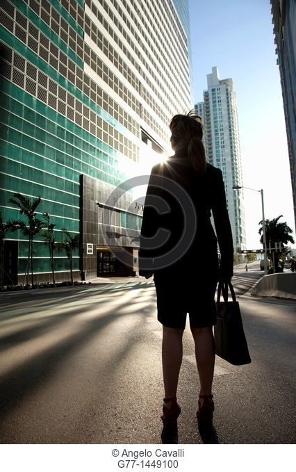 Business woman in front of building