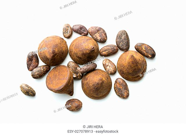 Sweet chocolate truffles and cocoa beans isolated on white background