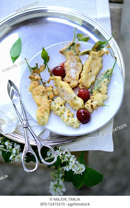 Fried bird cherry flowers with cherry compote