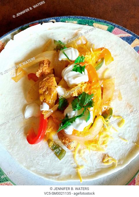 A chicken fajita on a plate