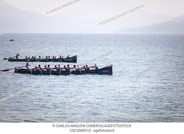 CASTRO URDIALES, SPAIN - JULY 15, 2018: Competition of boats, regata of trainera, San Pedro and Kaiku boats in action in the VI Bandera CaixaBank competition