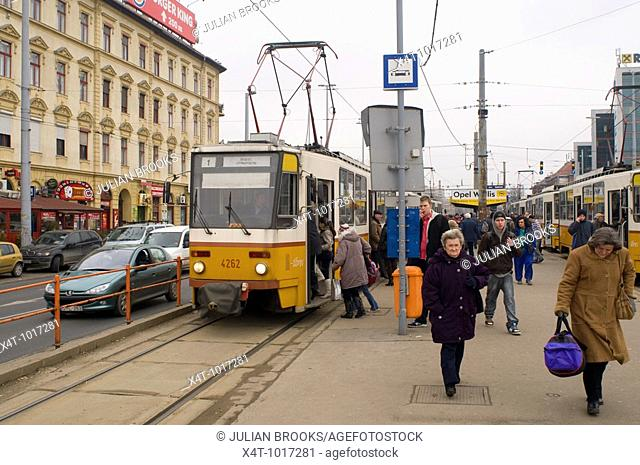 Busy street scene in Budapest, with trams and traffic