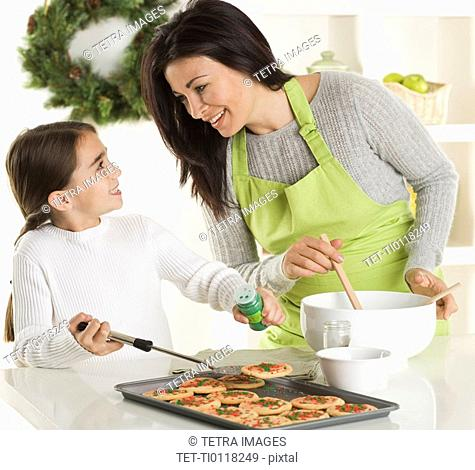 Mother and daughter baking Christmas cookies