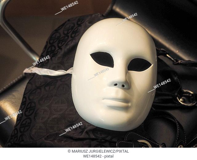 Stack of basic white plastic face masks on a table