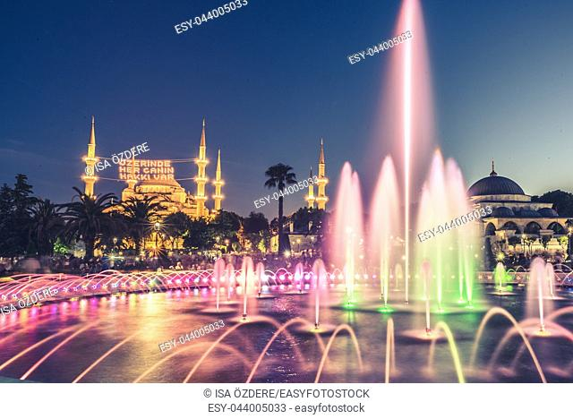 ISTANBUL, TURKEY-JUNE 11, 2017: Long exposure photography at Sultanahmet Mosque with fountain in the foreground during Ramadan Mont at Sultanahmet Park