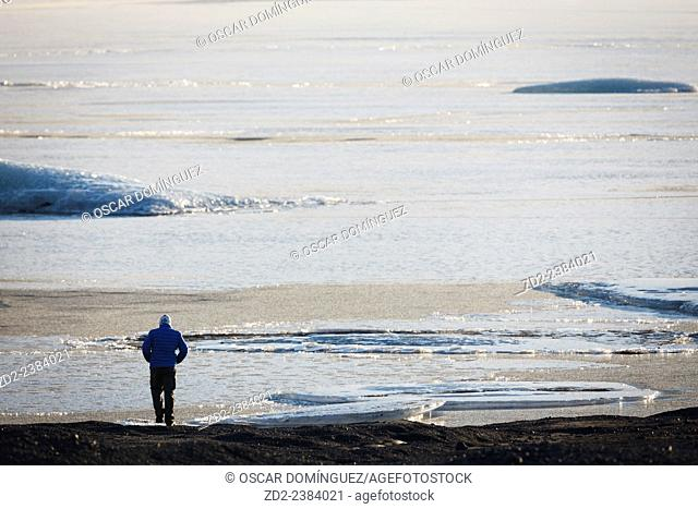 Man walking on Skaftafellsjokull glacier. Vatnajokull National Park. Iceland