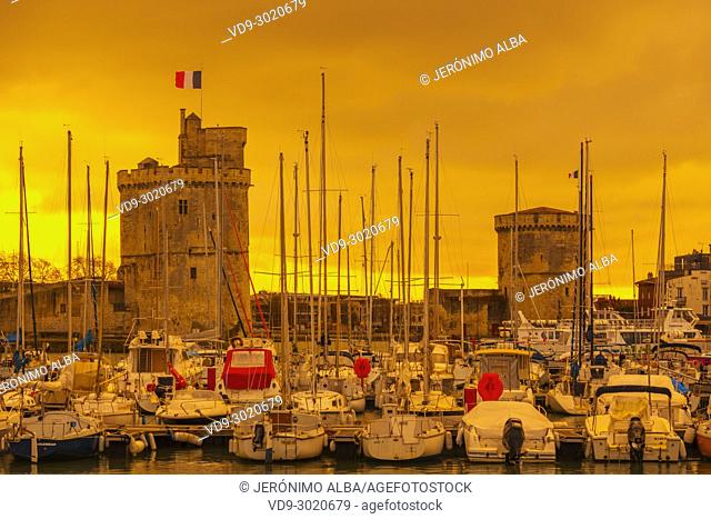 The old port with Saint-Nicolas Tower and Chain Tower at sunset. La Rochelle. Poiteau. Charente-Maritime. France