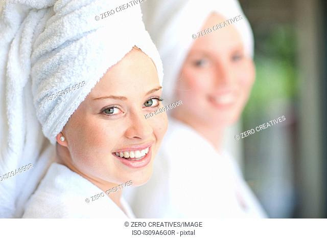 Young women with towels on heads in spa