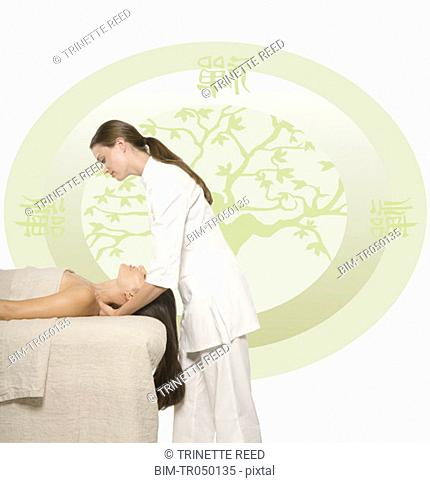 Woman having a massage against Oriental background