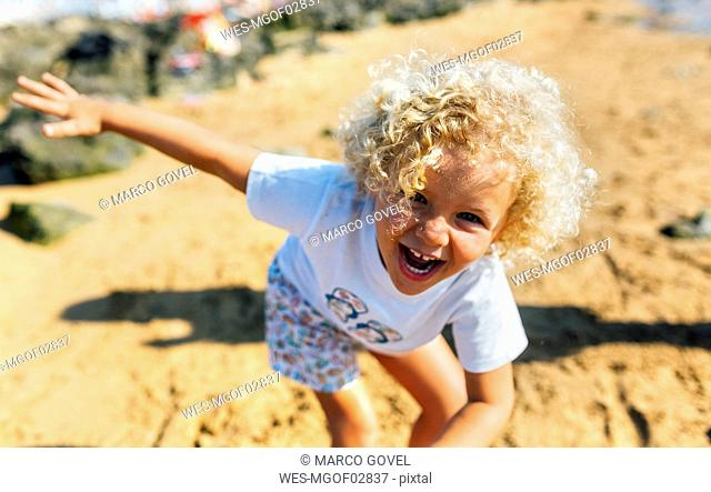 Portrait of laughing little boy on the beach