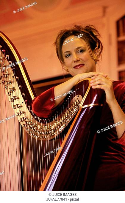 Female harpist with harp, Monastery Andechs, Bavaria, Germany