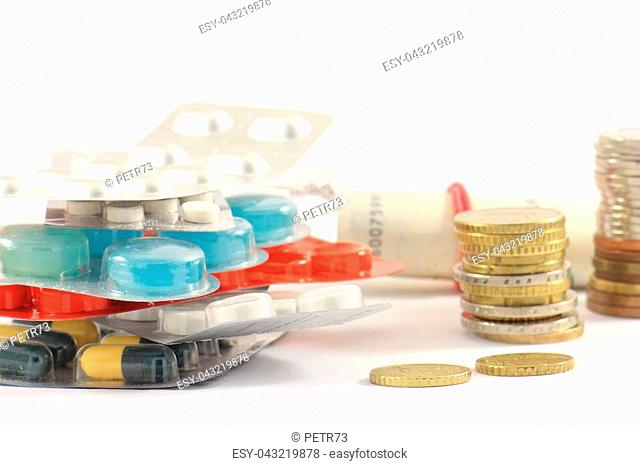 Different kinds of drugs and money on a light background